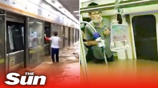 Terrified commuters risk drowning on subway as flood waters rise to shoulder level in China floods