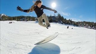 Skimboarding On Snow! Snowboarding Powder and Rails on a Skimboard!